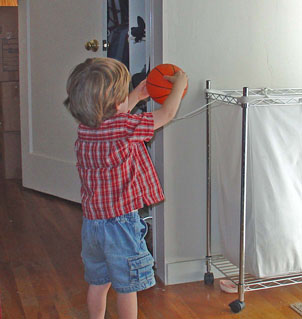 Johnny playing hamper-and-hanger basketball