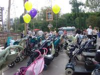 Acres of baby strollers sit outside many of the rides